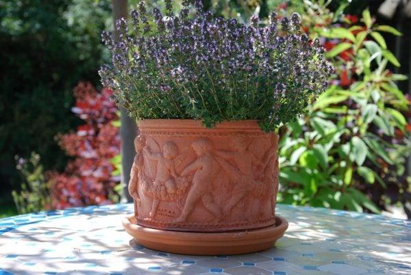 Cilindro con Putti snygga mindre krukor i terrakotta från Italien